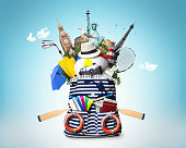 Striped sea bag with oars and plane tickets