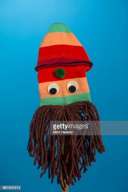 Striped Sock Puppet with Big Brown Beard on Blue Seamless
