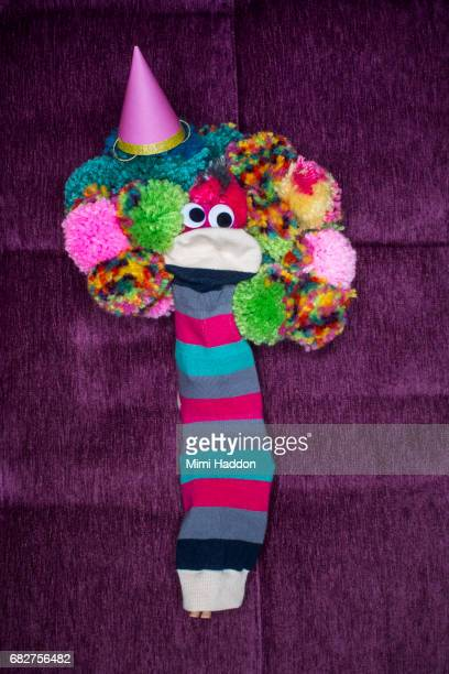 Striped Sock Puppet with Birthday Hat and Pom-pom Hair