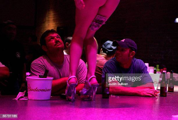 A stripper dances at the Deja Vu Showgirls Club on Bourbon Street in the French Quarter September 20 2005 in New Orleans Louisiana A few businesses...