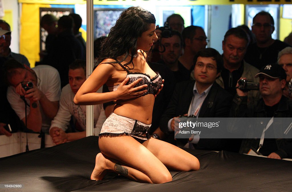 A stripper performs at the 2012 Venus Erotic Fair at Messe Berlin on October 18, 2012 in Berlin, Germany. The trade fair for the adult entertainment industry will be open from October 18 through 21.