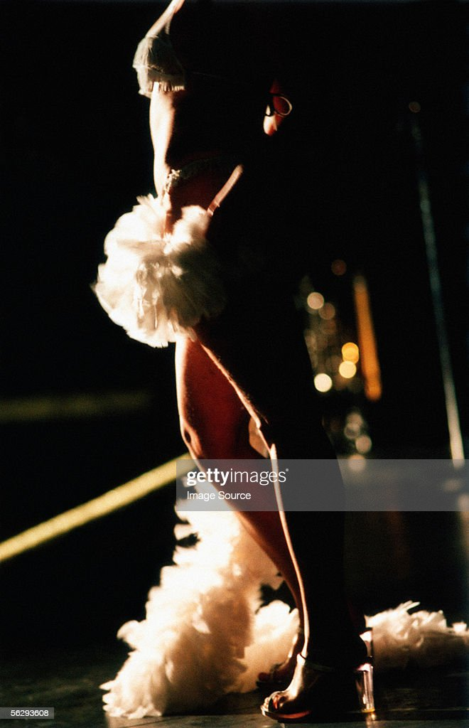 Stripper with a feather boa : Stock Photo