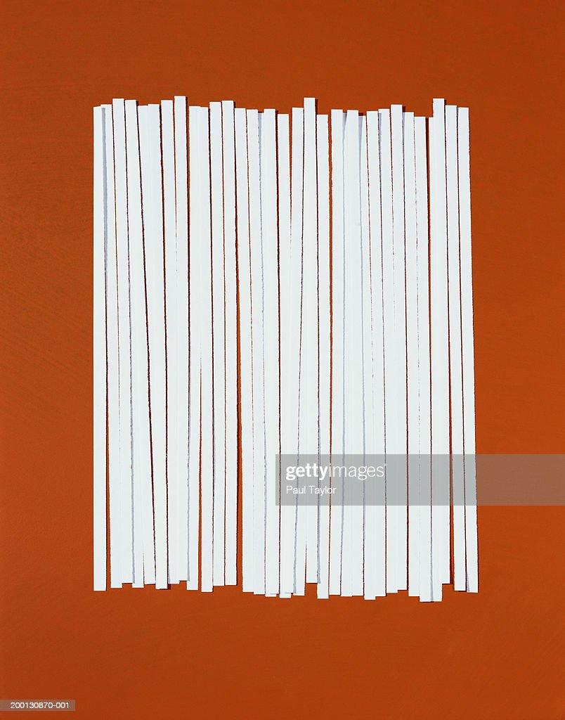 Strips of shredded paper in row