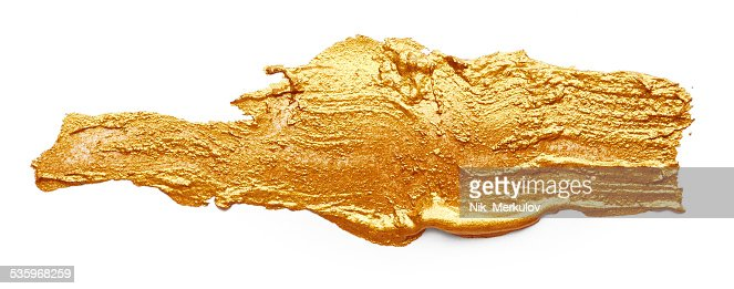 Strokes of golden paint : Stock Photo