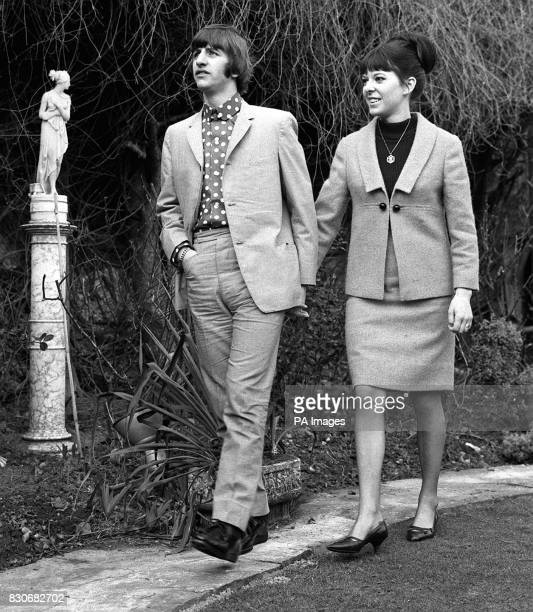 Strolling handinhand are Ringo Starr the Beatles drummer and his bride the former Maureen Cox They are pictured in the garden of the house in Princes...