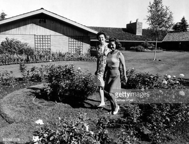 Strolling in the formal rose garden at the Thomas J Saine residence are Mrs William Teel left and Mrs Saine The backyard also Boasts a carpeted patio...