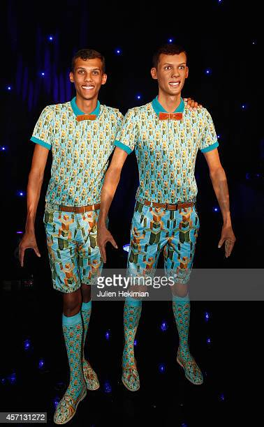 Stromae is pictured with his Wax statue at Musee Grevin on October 12 2014 in Paris France