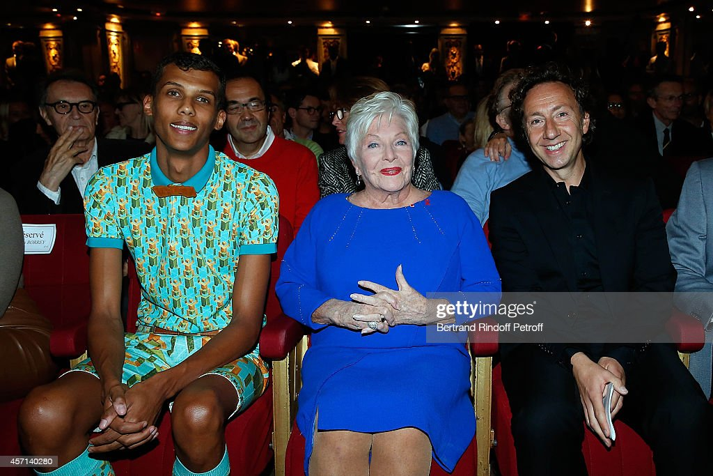 Stromae Line Renaud and Stephane Bern attend the Line Renaud and Stromae waxwork unveiling at Musee Grevin on October 12 2014 in Paris France