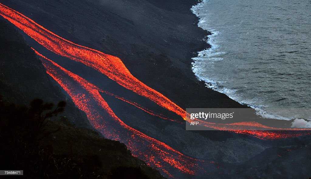 The flanks of the Stromboli volcano north of Sicily spewes lava towards the sea 28 February 2007 after one of Europe's most active volanoes churned...