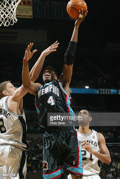 Stromile Swift of the Memphis Grizzlies shoots over Rasho Nesterovic of the San Antonio Spurs during game two round one of the 2004 NBA Western...