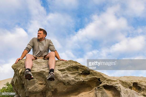 Strong Athletic Mature Man Enjoying a View after Exercise