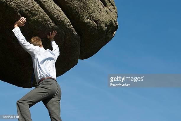 Strong Businessman Heaving Massive Boulder into Sky