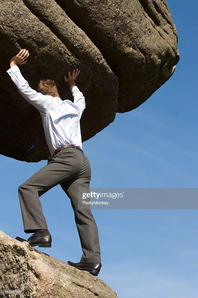 Strong Businessman Struggling Pushing Boulder Up