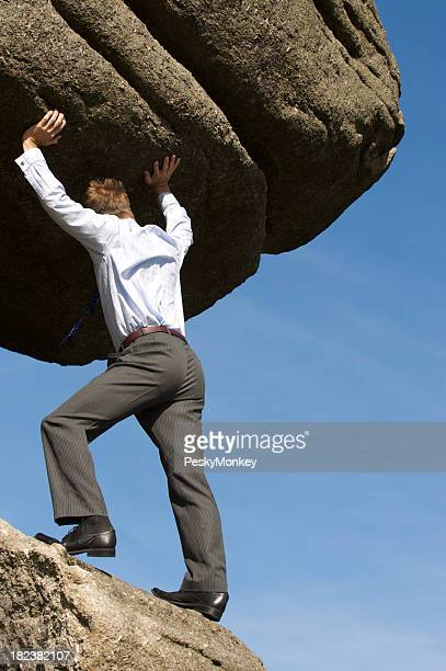 Strong Businessman Struggling Pushing Boulder Up