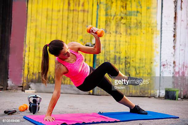 Strong female athlete showing exercises for legs and buttocks