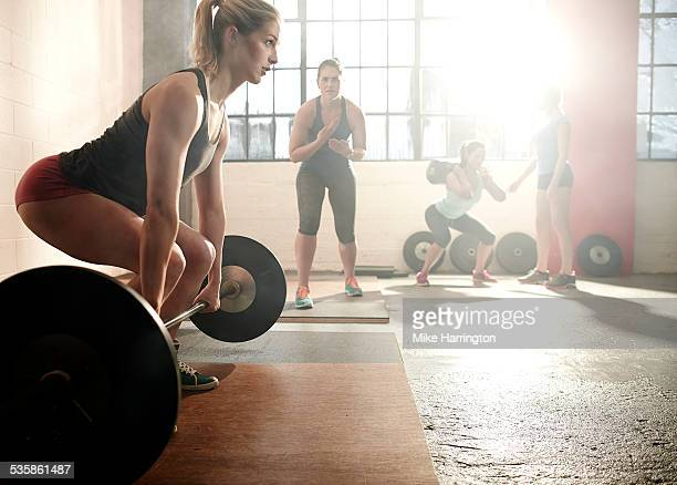 Strong female preparing for deadlift