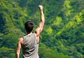 Happy fit man with his arms in the air celebrating. Healthy and active lifestyle concept.