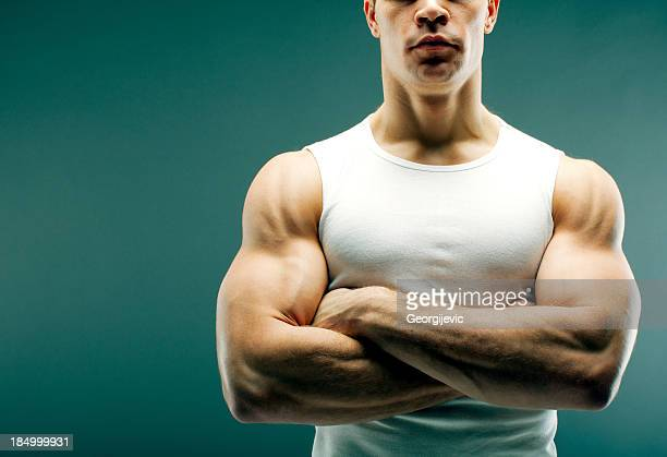 Strong guy with crossed arms