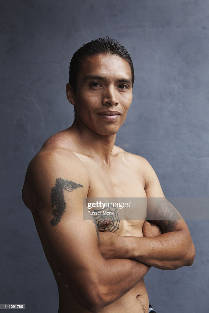 Strong hispanic young man with a cool attitude. : Stock Photo
