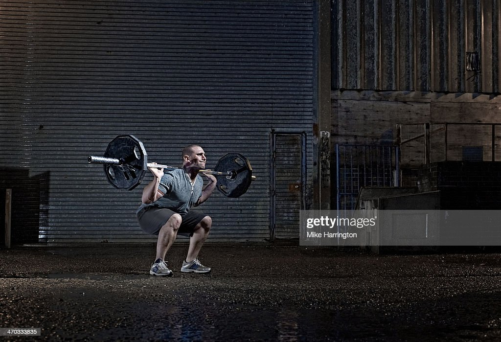 Strong Male Attempting to Lift Barbell