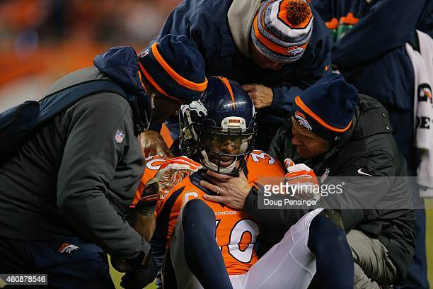 Strong safety David Bruton of the Denver Broncos is attended to by trainers after a play that would force him out of the game with a reported...