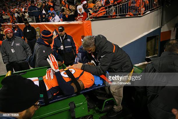 Strong safety David Bruton of the Denver Broncos is carted off the field after suffering a reported concussion during a game against the Oakland...