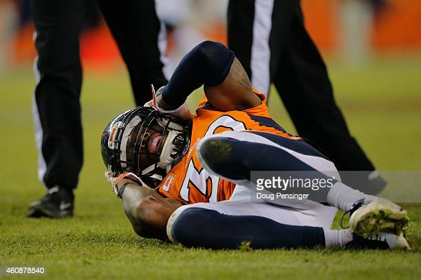 Strong safety David Bruton of the Denver Broncos lies on the ground in pain after a play that would force him out of the game with a reported...