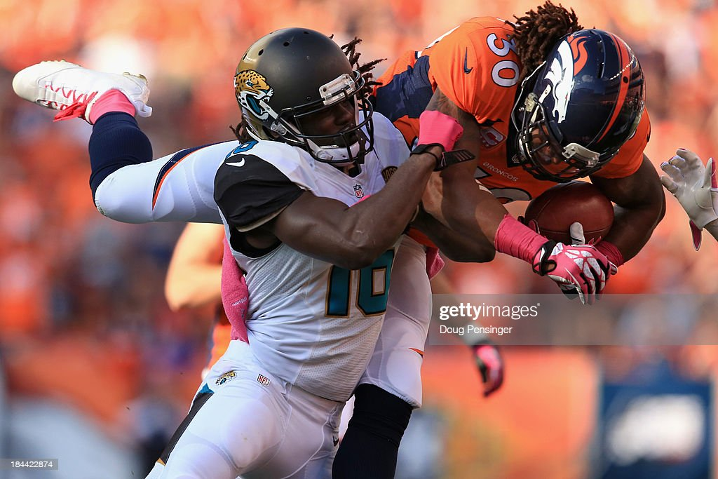 Strong safety David Bruton of the Denver Broncos rushes 35 yards for a first down on a fake punt and running back Denard Robinson of the Jacksonville...