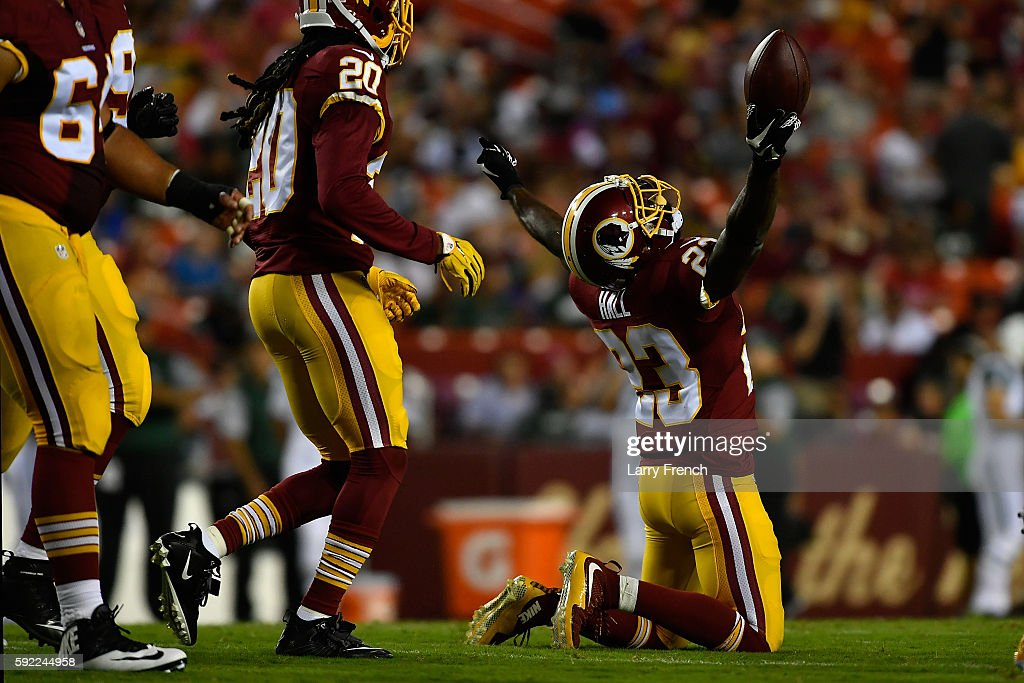 Strong safety DeAngelo Hall of the Washington Redskins celebrates a fumble recovery during the game against the New York Jets at FedExField on August...