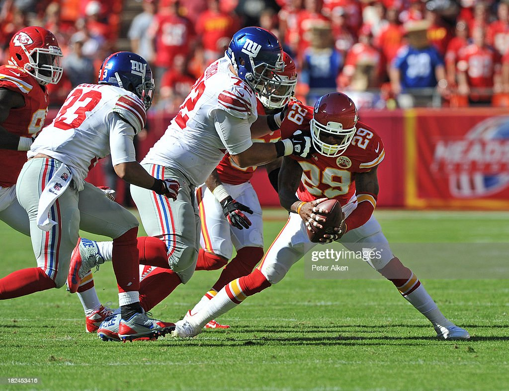 Strong Safety <a gi-track='captionPersonalityLinkClicked' href=/galleries/search?phrase=Eric+Berry+-+American+Football+Player&family=editorial&specificpeople=4501099 ng-click='$event.stopPropagation()'>Eric Berry</a> #29 of the Kansas City Chiefs recovers a fumble in front of offensive tackle <a gi-track='captionPersonalityLinkClicked' href=/galleries/search?phrase=Justin+Pugh&family=editorial&specificpeople=7204721 ng-click='$event.stopPropagation()'>Justin Pugh</a> #72 of the New York Giants during the second half on September 29, 2013 at Arrowhead Stadium in Kansas City, Missouri.
