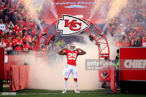 Strong safety Eric Berry of the Kansas City Chiefs runs through a fog machine while he is introduced prior to the game against the Denver Broncos at...