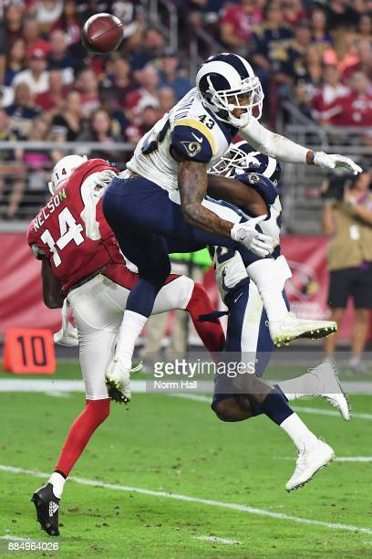 Strong safety John Johnson and free safety Lamarcus Joyner of the Los Angeles Rams break up a pass intended for wide receiver JJ Nelson of the...