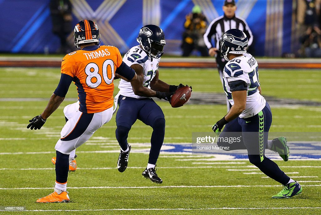 Strong safety <a gi-track='captionPersonalityLinkClicked' href=/galleries/search?phrase=Kam+Chancellor&family=editorial&specificpeople=4489525 ng-click='$event.stopPropagation()'>Kam Chancellor</a> #31 of the Seattle Seahawks intercepts a pass from quarterback Peyton Manning #18 of the Denver Broncos intended for tight end <a gi-track='captionPersonalityLinkClicked' href=/galleries/search?phrase=Julius+Thomas+-+American+Football+Player&family=editorial&specificpeople=11333769 ng-click='$event.stopPropagation()'>Julius Thomas</a> #80 of the Denver Broncos in the first quarter during Super Bowl XLVIII at MetLife Stadium on February 2, 2014 in East Rutherford, New Jersey.