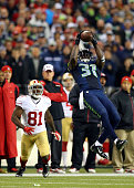 Strong safety Kam Chancellor of the Seattle Seahawks makes an interception in the fourth quarter in front of wide receiver Anquan Boldin of the San...