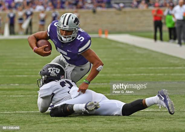 Strong safety Ridwan Issahaku of the TCU Horned Frogs tackles quarterback Alex Delton of the Kansas State Wildcats during the second half on October...