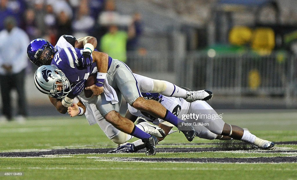 Strong safety Sam Carter #17 of the TCU Horned Frogs sacks quarterback Jake Waters #15 of the Kansas State Wildcats during the second half on November 16, 2013 at Bill Snyder Family Stadium in Manhattan, Kansas. Kansas State defeated TCU