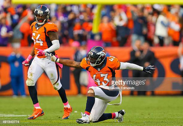 Strong safety TJ Ward and Brandon Marshall of the Denver Broncos celebrates after causing a gameending fumble against the Minnesota Vikings at Sports...