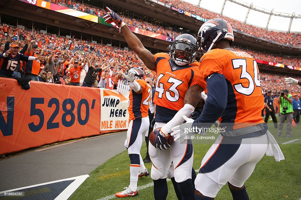 Strong safety T.J. Ward #43 of the Denver Broncos celebrates after intercepting the ball in the third quarter of the game against the San Diego Chargers at Sports Authority Field at Mile High on October 30, 2016 in Denver, Colorado.