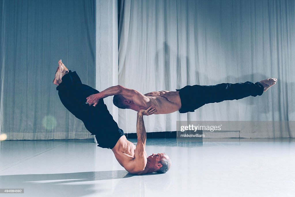 Strong teamwork with two acrobats supporting each other