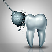 Strong tooth enamel and teeth strength dental or dentistry  symbol as awrecking ball being demolished by a solid white molar as a medicine concept as a 3D render.