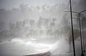 Strong winds and rain pound the seawall hours before Typhoon Hagupit passes near the city of Legazpi on December 7 2014 Typhoon Hagupit tore apart...