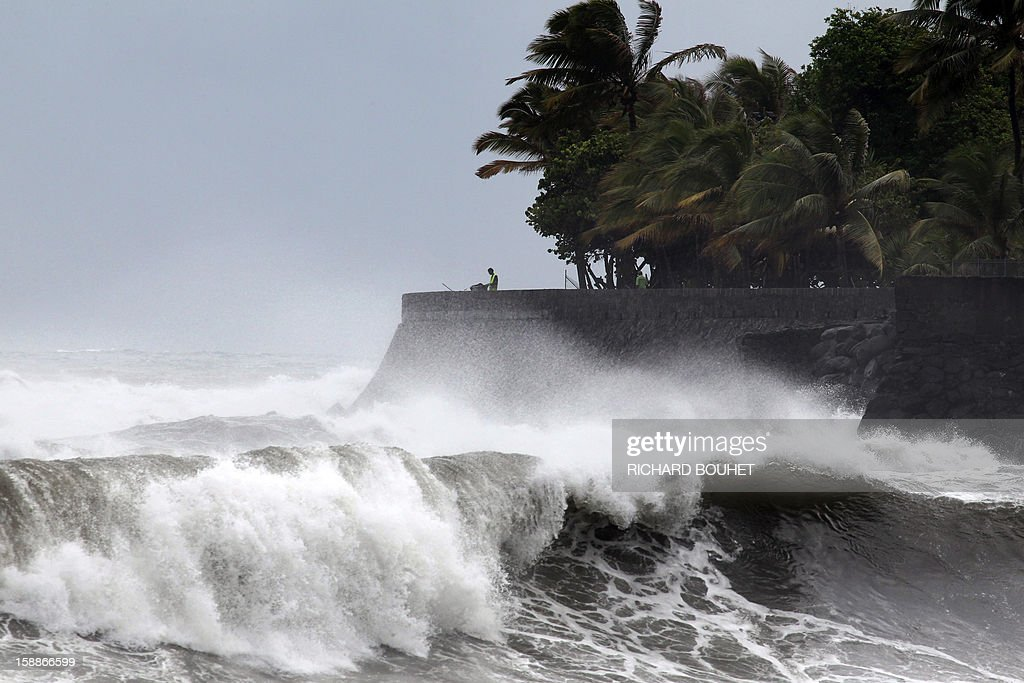 Strong winds and waves lash the shoreline, on January 2, 2013 in Saint-Denis de la Reunion, a French island located in the Indian Ocean, as tropical storm Dumile is forecast to strike the island as a tropical cyclone later today.