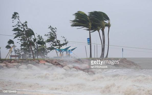 Strong winds are seen hitting a section of the 'Strand' on February 3 2011 in Townsville Australia So far no deaths or serious injuriees have been...