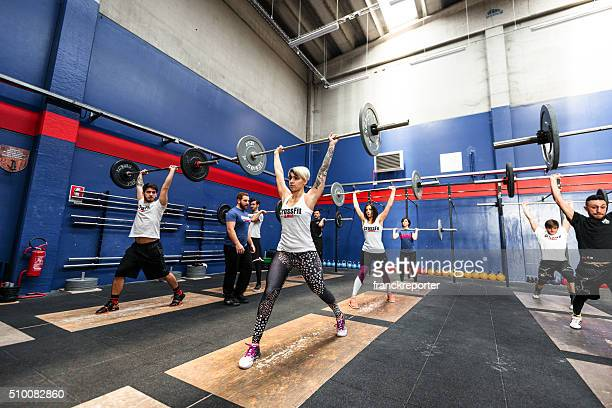 strong woman weightlifting on a gym big gym