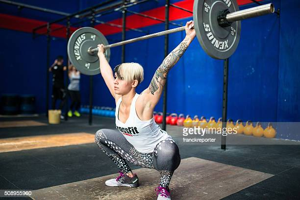 strong woman weightlifting on a gym La Mole gym
