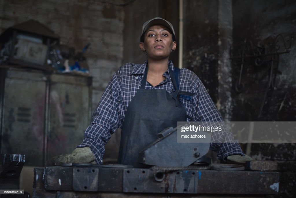 Strong woman with dirt on face : Stock Photo