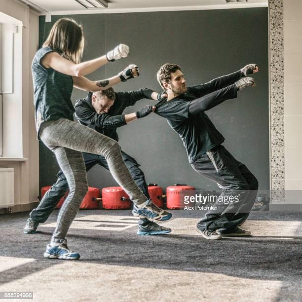 Strong women practicing self-defense martial art Krav Maga