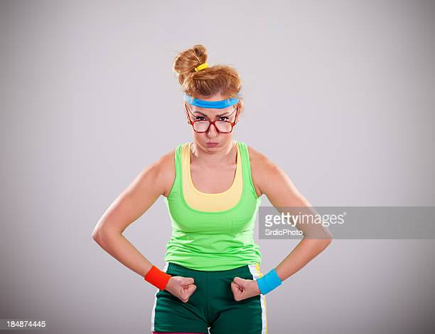 Strongest female geek flexing biceps muscles on gray background