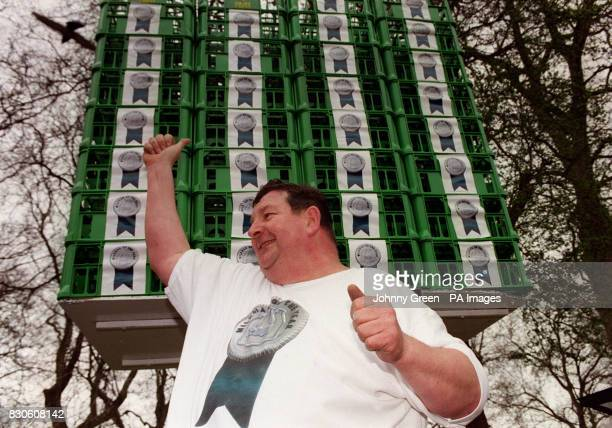 Strongman John Evans from Derbyshire celebrates after smashing the world record of milk crate balancing in Hyde Park London Mr Evans balanced 96...