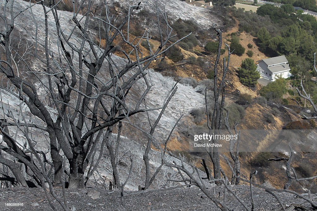A structure that was saved by firefighters sits near burned chaparral habitat in Hidden Valley at the Springs fire on May 4, 2013 near Camarillo, California. Improving weather conditions are helping firefighters get the upper hand on the wildfire which has grown to 28,000 acres and is now 56 percent contained.